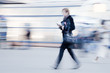 Motion blurred businesswoman rushing to office
