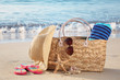 Summer beach bag on sandy beach