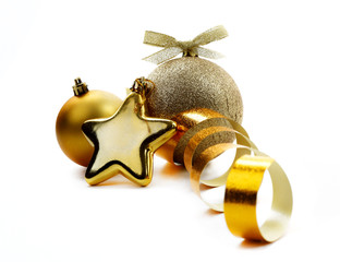 Christmas golden balls hanging with ribbons on white background