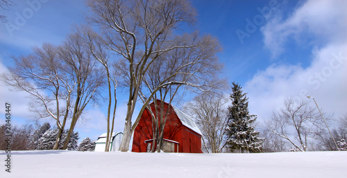 Winter scene old red barn in snow