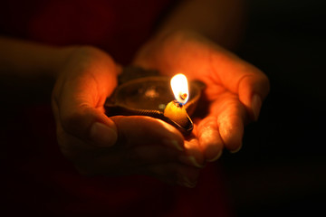 Oil lamp in hands