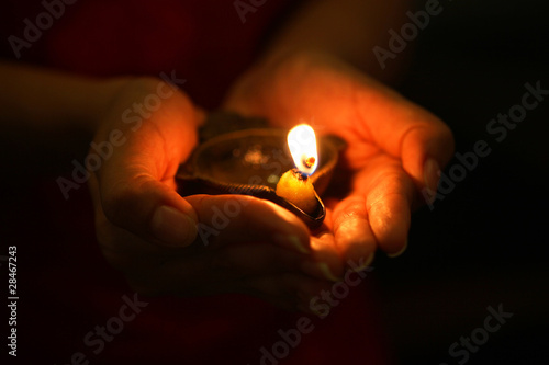 Oil lamp in hands - 28467243