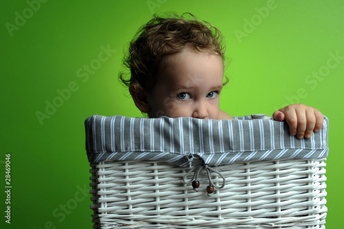 Baby sitting in a basket