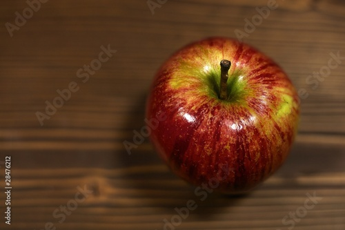 Fresh gala apple on rustic wood background with copy space