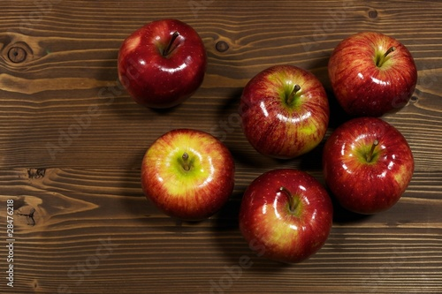 Fresh gala apples on rustic wood background with copy space