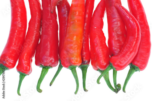 Red Chili Peppers On White Background