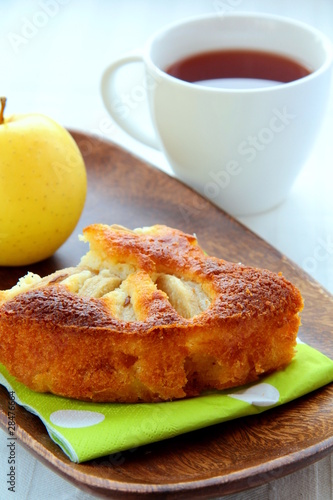Beautiful delicious apple pie on a wooden plate