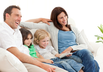 Happy family watching television together