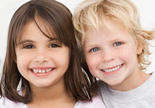 Portrait of two happy children in the kitchen