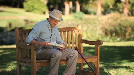 Old man getting up from a bench