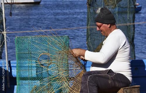 Italy, Sicily, a fisherman making a lobster pot