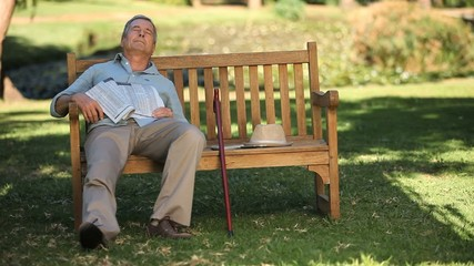 Old man waking up on a bench