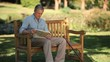 Senior man reading a book sitting on a bench