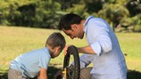 Father and son fixing a bicycle
