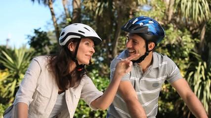 Couple doing a walk with bike