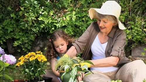Grandmother and her granddaughter gardening