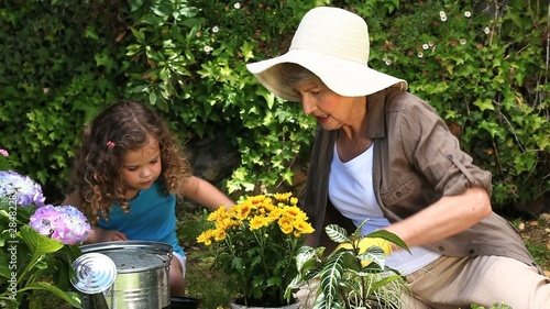 Old woman and a child gardening