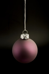 Red christmas ball on silver string