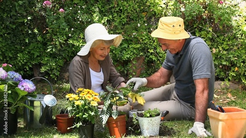 Old man gardening with his wife