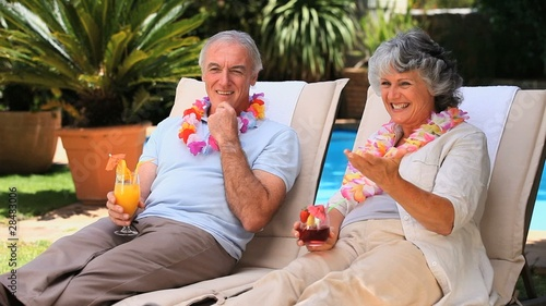 Old couple relaxing on deckchairs