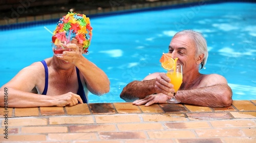 Happy mature couple relaxing in the swimming pool
