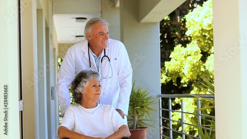 Doctor taking a patient for a walk
