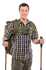 A smiling man in sportswear with backpack and hiking poles
