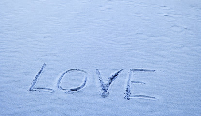 Love Written in Blue Sand on a Sunny Day