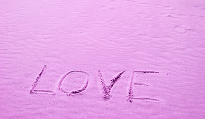 Love Written in Pink Sand on a Sunny Day