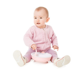 Beautiful baby with plate and spoon