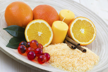 orange bath salt with fresh fruits - beauty treatment