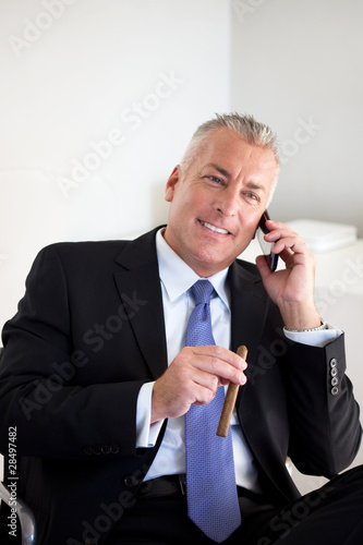 Businessman holding a cigar