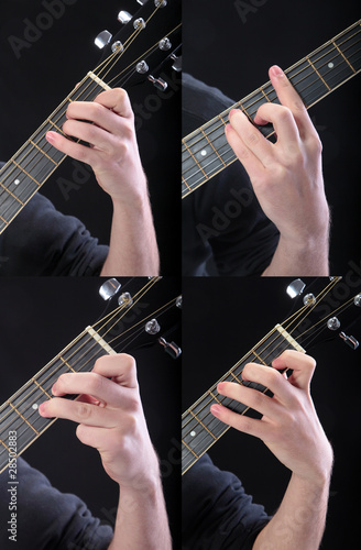 Human hand taking  accord at guitar