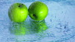 Apples under running water