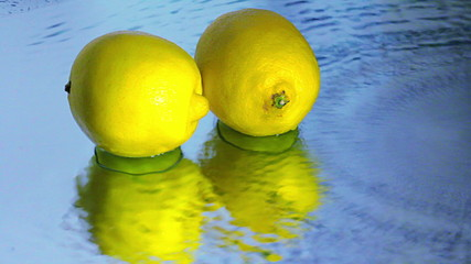 Lemons are reflected in the flow of water
