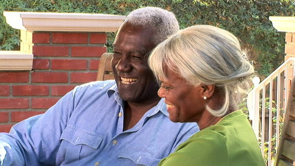 Close up portrait of senior couple outdoors on the patio