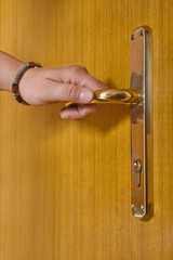 Woman holding door handle