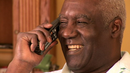 Portrait of senior man indoors talking on cell phone
