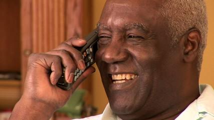 Portrait of senior man indoors talking on cell phone