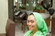 Happy young woman at salon