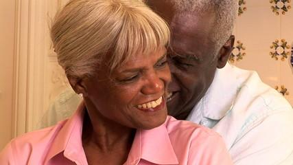 Close up portrait of senior couple in kitchen