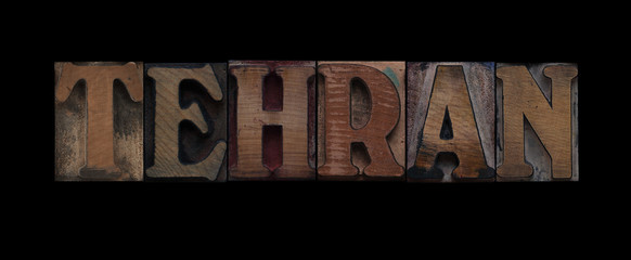 the word Tehran in old letterpress wood type