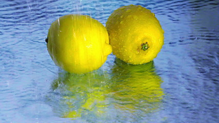 Lemons under running water