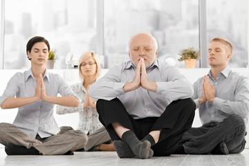 Businessteam doing yoga meditation