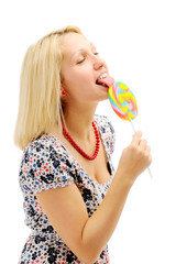 Attractive blonde licking lollipop