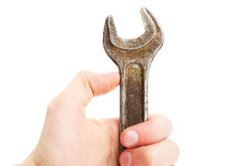 Hand holding spanner; wrench. Repair