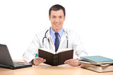 Medical doctor posing in his office