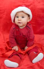 Weihnachtsbaby mit roter Schleife