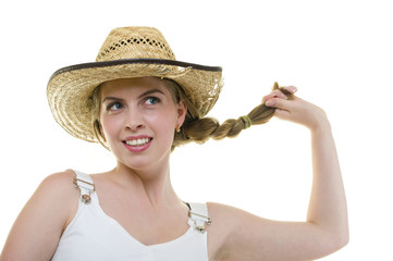 young woman in worn straw  hat