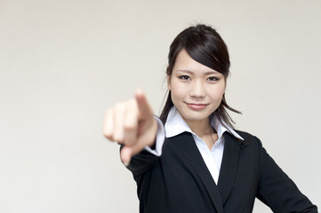 a portrait of young business woman pointing